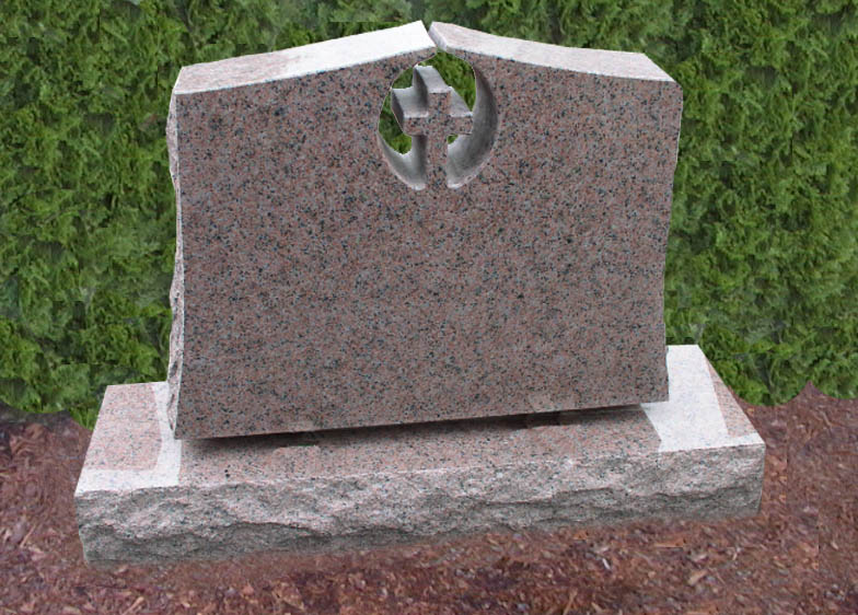 A small memorial with an embedded engraved cross at the top.