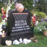 A memorial styled with a basketball and hoop.