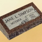 "A simple monument labeled ""Jane L. Simpson"""