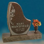 "A memorial with engraved flowers labeled ""Mary Mansfield"""