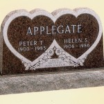 "A memorial labled ""Applegate"" with a double heart pattern."
