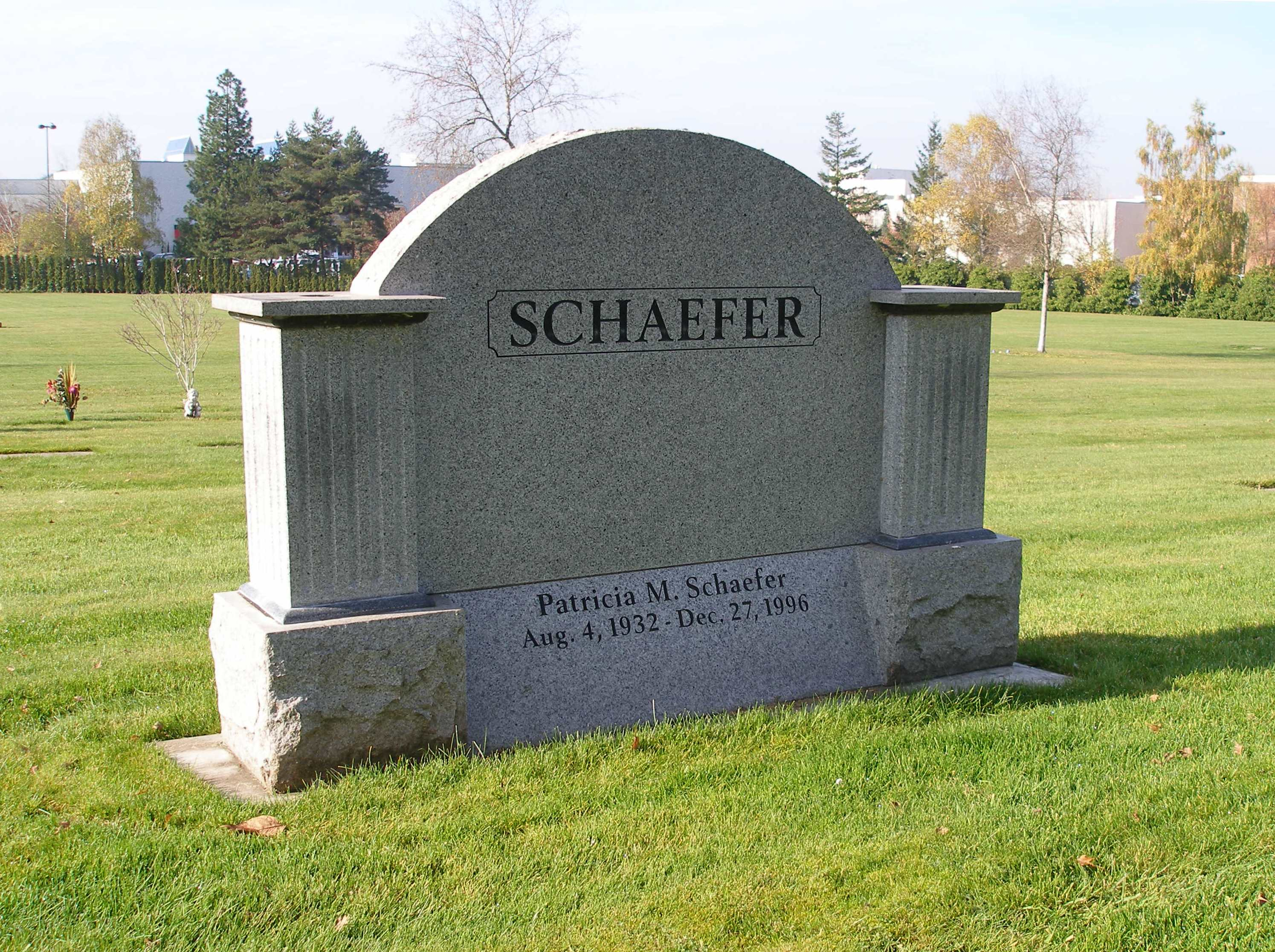 """An arch shaped memorial labeled """"Schaefer"""""""