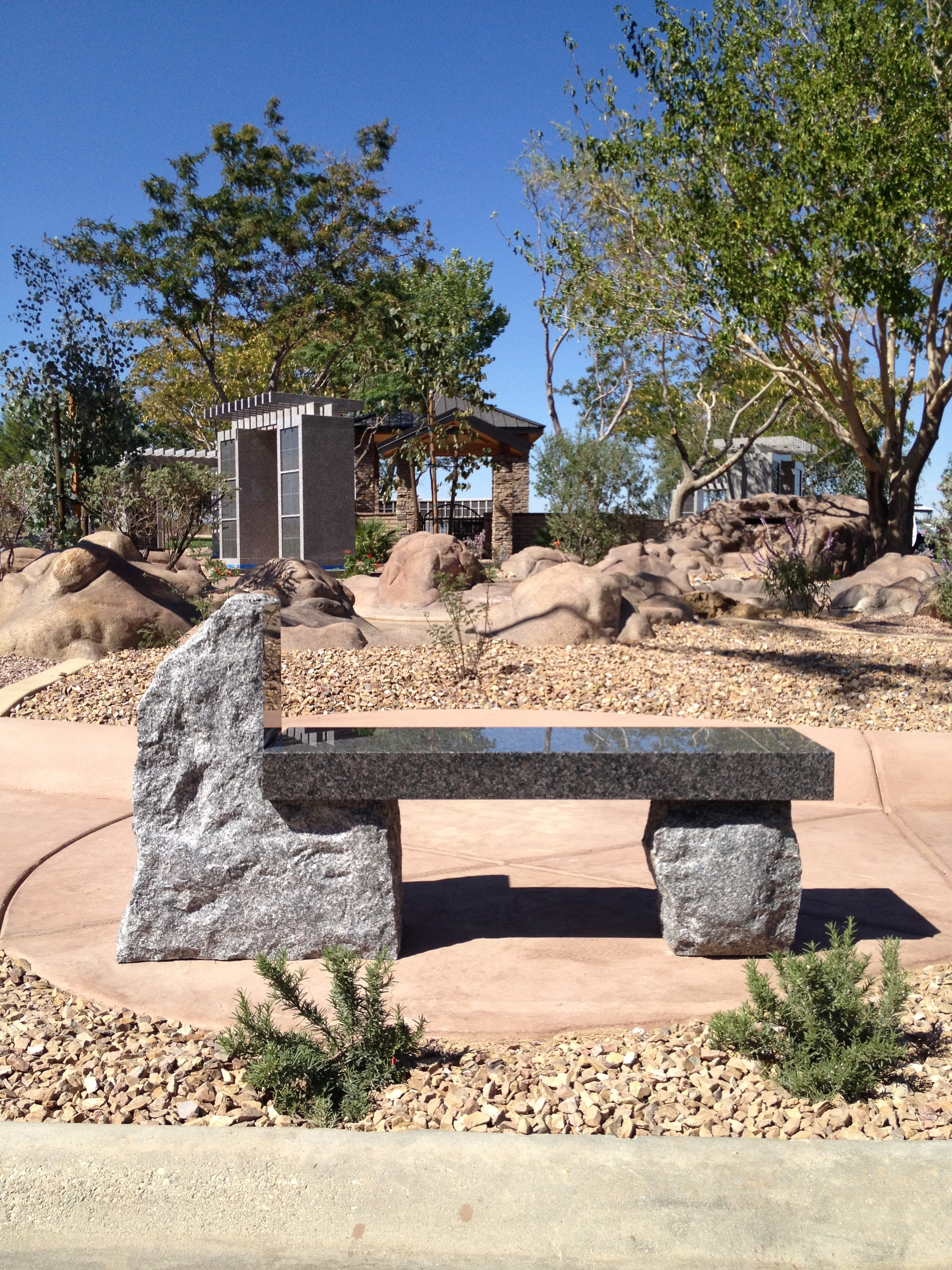 A bench memorial with rough stone supports