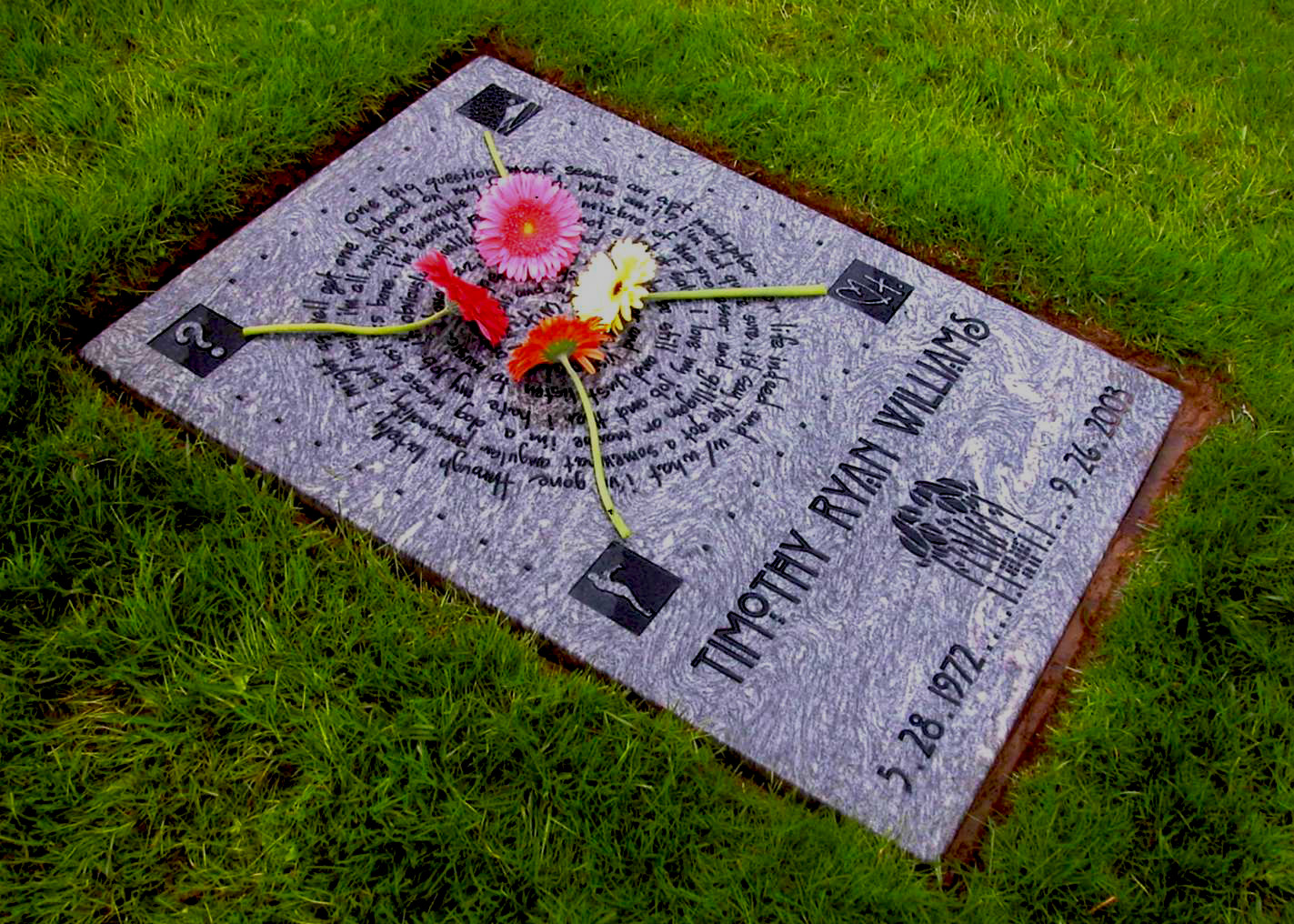 An in ground memorial for Timothy Williams